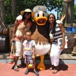 family with Frontier Donald Duck at Magic Kingdom